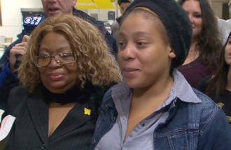 Jakadrien Turner arriving home in Texas, standing with her grandmother (left)