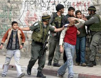 IDF soldiers stop and arrest a group of young Palestinian men