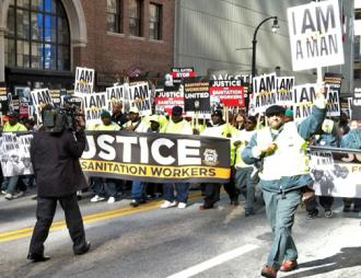 DeKalb County sanitation workers march down Peachtree Street in downtown Atlanta (Ben Smith | SW)