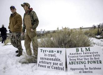 Militia members near the entrance to the Malheur National Wildlife Refuge Center