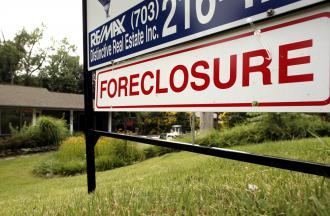 A foreclosure sign in front of a house in Falls Church, Va. (Kevin Lamarque | Reuters)