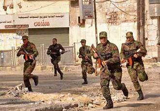 Syrian troops on an operation in city streets