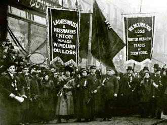 Garment workers and supporters march and mourn those killed in the fire at Triangle Shirtwaist factory