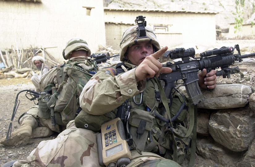 U.S. soldiers take up positions in the town of Gangikhel in southeastern Afghanistan
