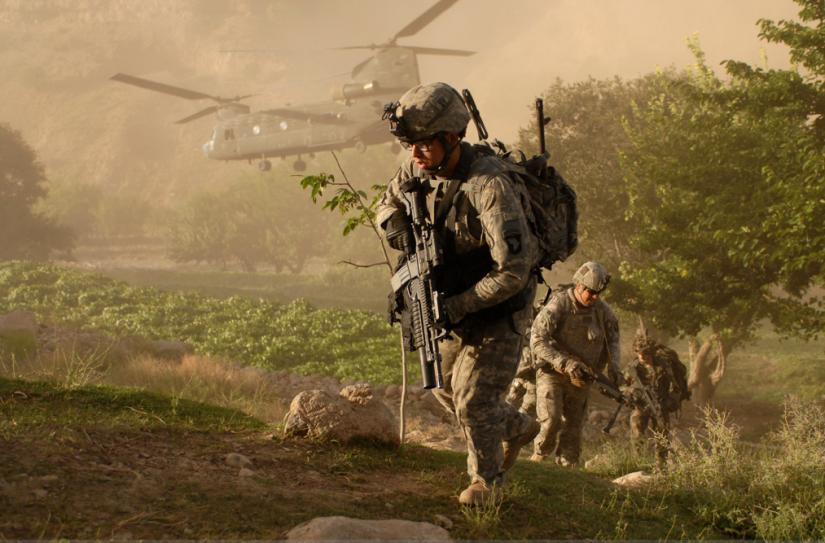 U.S. troops mounting an assault on a village in Parwan Province, Afghanistan
