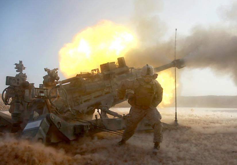 Marines launch artillery fire during the assault on Marja