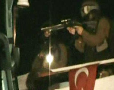 Israeli soldiers fire on solidarity activists after landing on the deck of the lead ship in the Gaza Freedom Flotilla