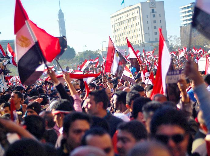 Egyptians celebrate the downfall of dictator Hosni Mubarak
