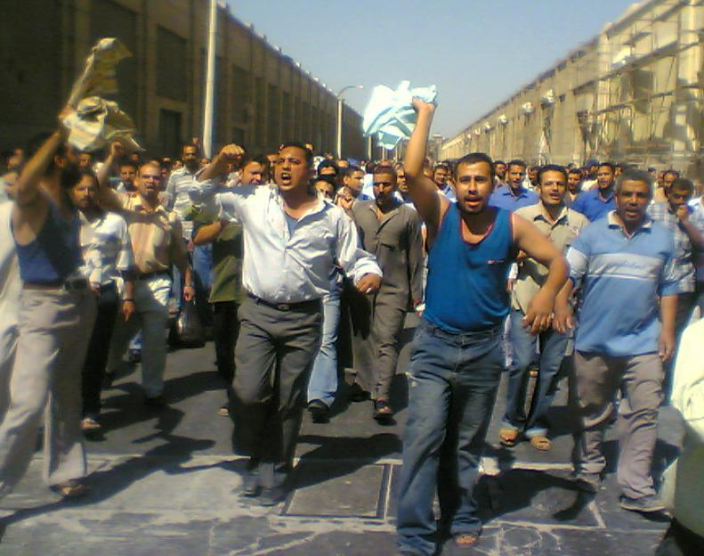 Workers march through the streets of El-Mahalla el-Kubra
