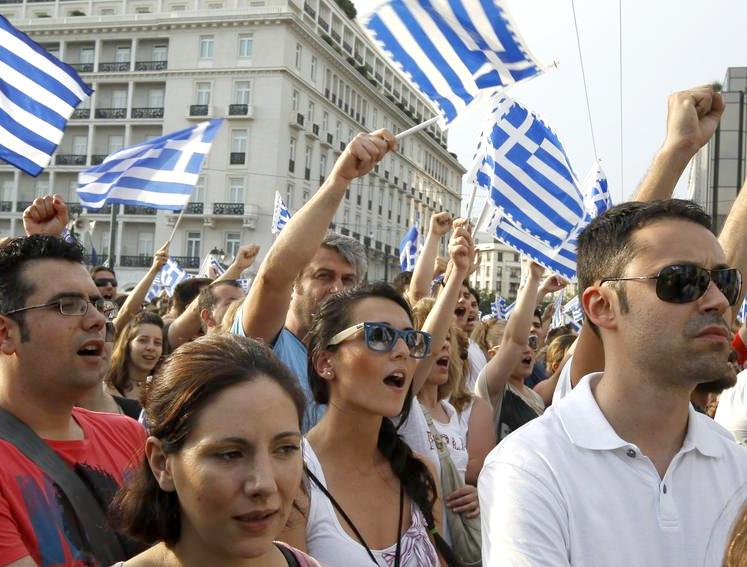 Protesters outside the Greek parliament chant and rally against austerity