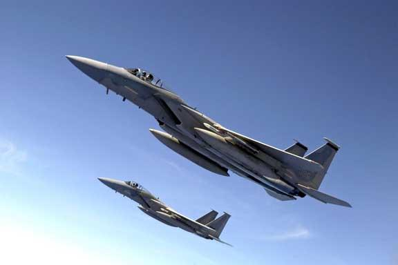 Two F-15 Eagle fighter jets perform a training exercise
