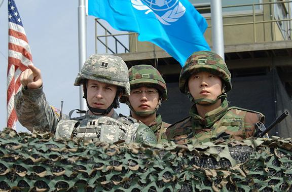 U.S. and South Korean soldiers survey the demilitarized zone from an observation post