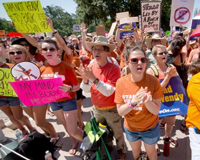 Protesters crowd around the Texas Capitol building to protest a harsh anti-abortion bill