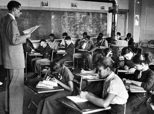 Students study in an all-Black segregated school