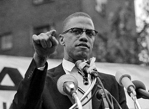 Malcolm X speaking to a crowd in Harlem