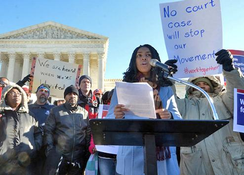 California Teachers Association member Maya Walker speaks outside the U.S. Supreme Court building