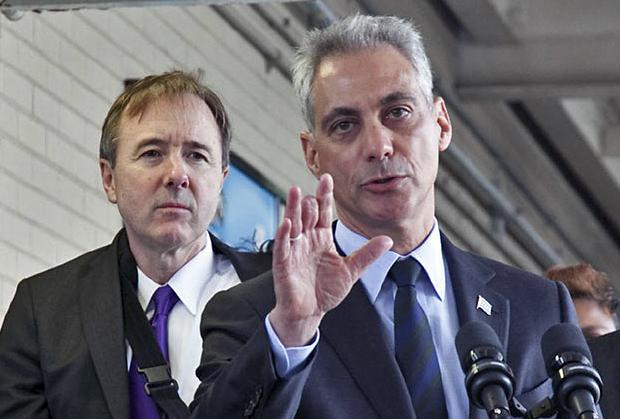 Chicago Mayor Rahm Emanuel speaks to the press flanked by CPS CEO Forrest Claypool
