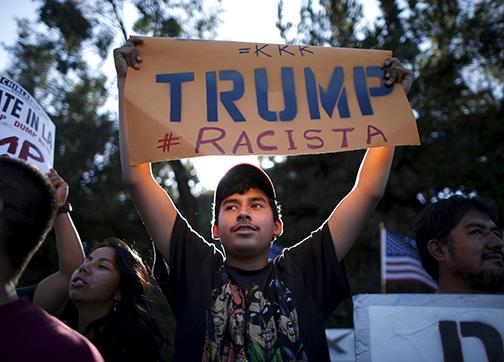 Protesters stand up against Donald Trump's bigotry and hate