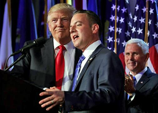 Donald Trump with new Chief of Staff Reince Priebus (speaking) and Mike Pence (right)