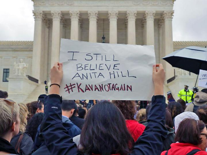 Protesters demand justice for Anita Hill outside the Supreme Court