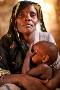 A woman and her granddaughter in a settlement for internally displaced persons in South Galkayo, Somalia.