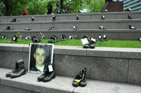 Combat boots set out as a tribute to fallen soldiers at an antiwar Memorial Day event in Chicago in 2008