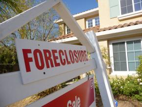 One in every 30 mortgage loans was in foreclosure by the end of 2008