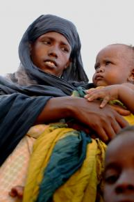 A young woman and her two young children in a refugee settlement in Bossaso, Puntland, Somalia
