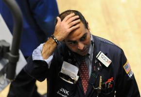 A Wall Street trader watches as the stock market crashes in reaction to the bankruptcy of Lehman Brothers