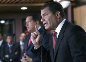 Ecuador's President Rafael Correa (right) speaks with Venezuelan President Hugo Chávez