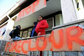 Protesters and family gathered to stop the eviction of Melonie Griffiths-Evans in the Dorchester neighborhood of Boston