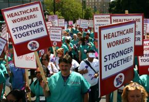 Thousands of health care workers marched in September against a plan to put the UHW in trusteeship
