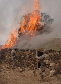 U.S. soldiers burn down a house suspected of being used by the Taliban