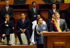 Rafael Correa gives his inaugural address as Venezuela's Hugo Chávez and Brazil's Luiz Inácio Lula da Silva look on