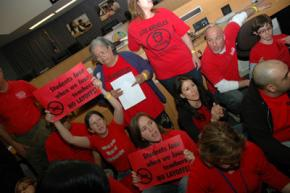 Los Angeles teachers sit in at a school board meeting to protest planned layoffs