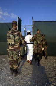 A detainee under guard at Guantánamo Bay