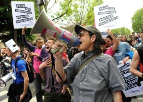 Demonstrators march on May Day in Paris in a protest that united all the trade union federations