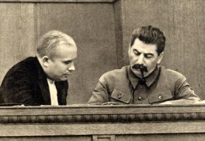 Joseph Stalin (right) sits with Nikita Khrushchev