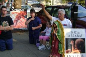 Anti-choice protesters harass patients at the only abortion clinic in Louisville, Ky.