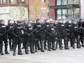 A line of riot police brandish batons at G20 protesters in Pittsburgh