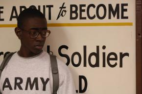 A new recruit to the Army waits in line during the intake process
