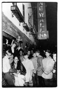 People gather outside the Stonewall Inn during several days of rioting against police harassment