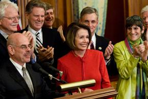 Democratic leaders celebrate the passage of a health care bill in the House of Representatives