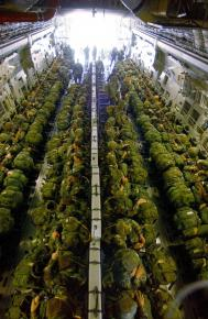 U.S. soldiers from the 82nd Airborne packed into a troop transport plane