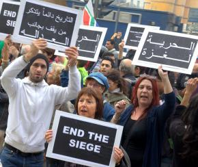Participants in the Gaza Freedom March call for an end to the siege at a Cairo protest