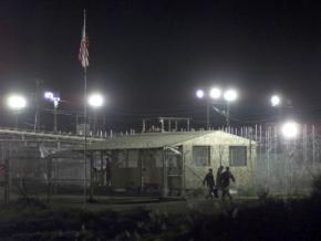 A prisoner is moved from one building to another at the prison camp at Guantánamo Bay