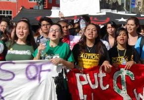 Students march against cuts spurred by the financial crisis