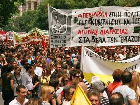 Tens of thousands of people march through the streets of Athens during a general strike