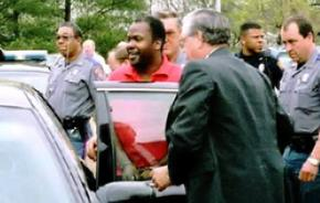 Curtis Flowers being escorted by police