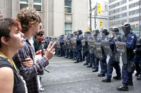 Protesters face police clad in riot gear in Toronto during the G20 summit